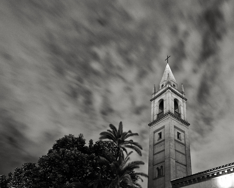 Long Exposure of clouds moving across the sky above the Bell Tower of the LA Full Gospel Church in Los Feliz, CA. The building is a 1920s Italian Renaissance Revival structure and a Los Angeles historical monument.