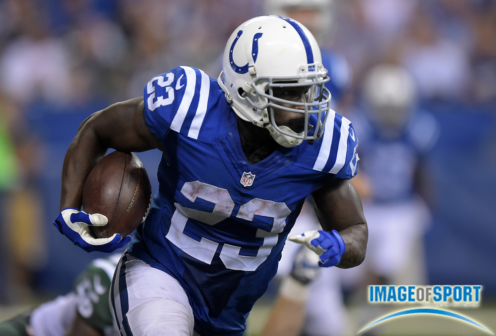 Sep 21, 2015; Indianapolis, IN, USA; Indianapolis Colts running back Frank Gore (23) carries the ball during an NFL football game against the New York Jets at Lucas Oil Stadium.