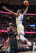 CLEVELAND, OH - JANUARY 15: Kevin Durant #35 of the Golden State Warriors goes up for the dunk over LeBron James #23 of the Cleveland Cavaliers at Quicken Loans Arena on January 15, 2018 in Cleveland, Ohio.