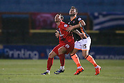 York City forward Jake Hyde  and Exeter City defender Jordan Moore-Taylor  challenge for the ball  during the Sky Bet League 2 match between York City and Exeter City at Bootham Crescent, York, England on 16 February 2016. Photo by Simon Davies.