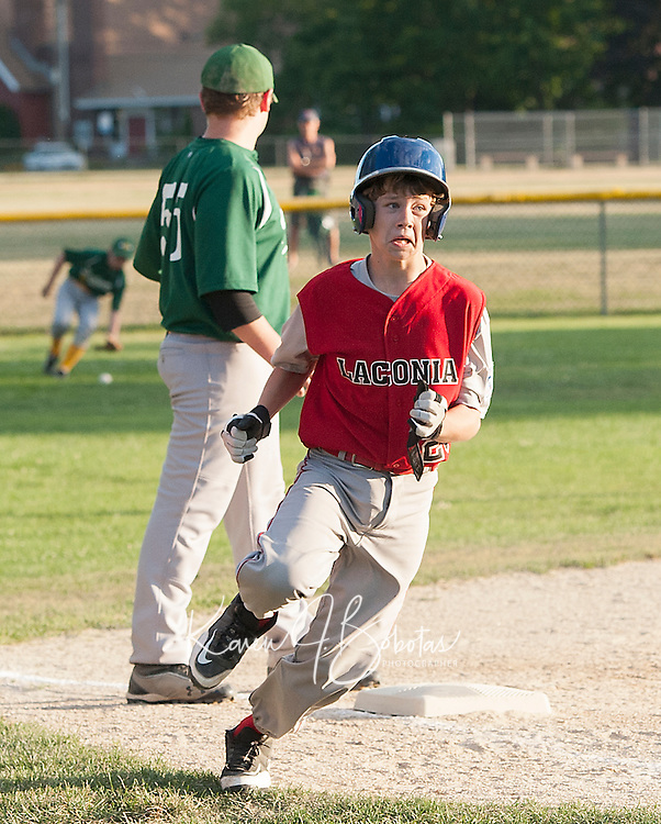 Laconia's Jake Nelson rounds third for home on a double hit by Carter Doherty during the sixth inning against Hooksett on Colby Field for the Laconia Little League 11/12 All Star matchup Monday.  (Karen Bobotas/for the Laconia Daily Sun)