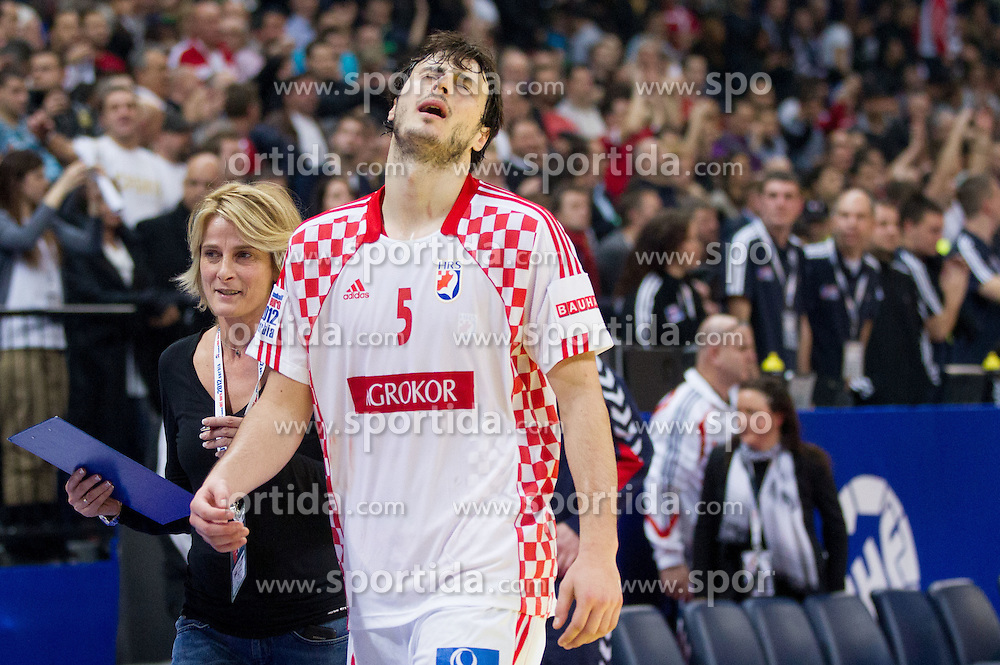 Domagoj Duvnjak of Croatia disappointed after the handball match between Serbia and Croatia in 2nd Semifinal at 10th EHF European Handball Championship Serbia 2012, on January 27, 2012 in Beogradska Arena, Belgrade, Serbia. Serbia defeated Croatia 26-22. (Photo By Vid Ponikvar / Sportida.com)