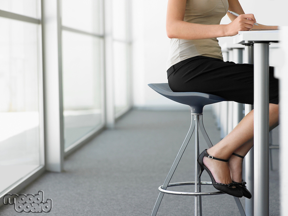 Businesswoman Taking Notes at table low section