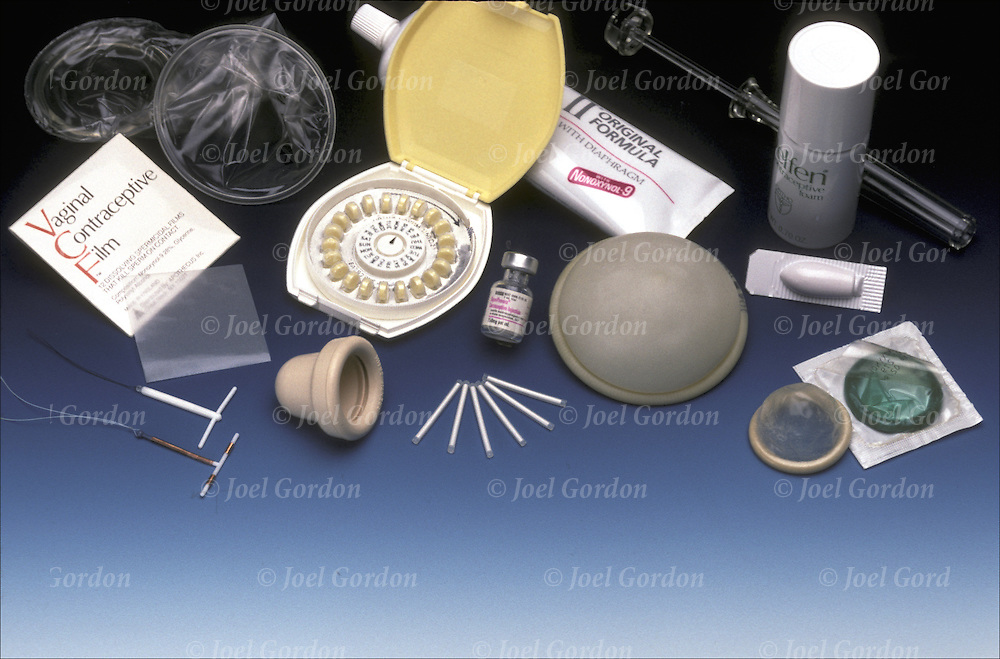 Group photo of contraceptives - birth control devices Male condoms, Copper-T IUD, VCF, female condom, Cervical cap, Diaphragm, Jelly,  Oral contraceptives, Spermicide,