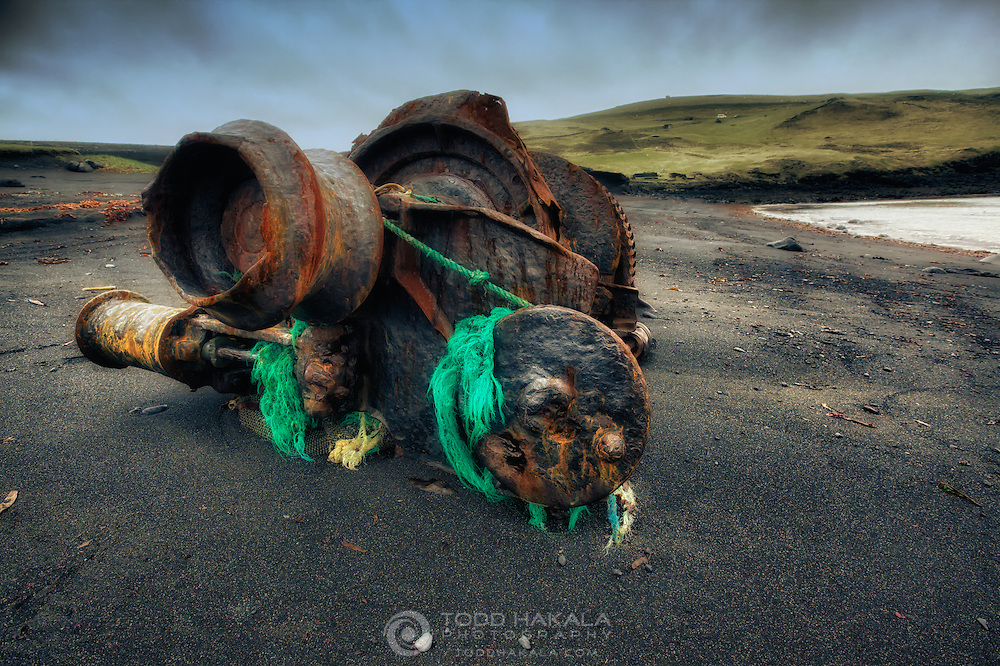 A large piece of machinery left to rust on a beach in Vestmannaeyer.