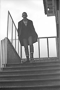 Gavin Watson walking down stairs, Windsor, UK, 1980s.