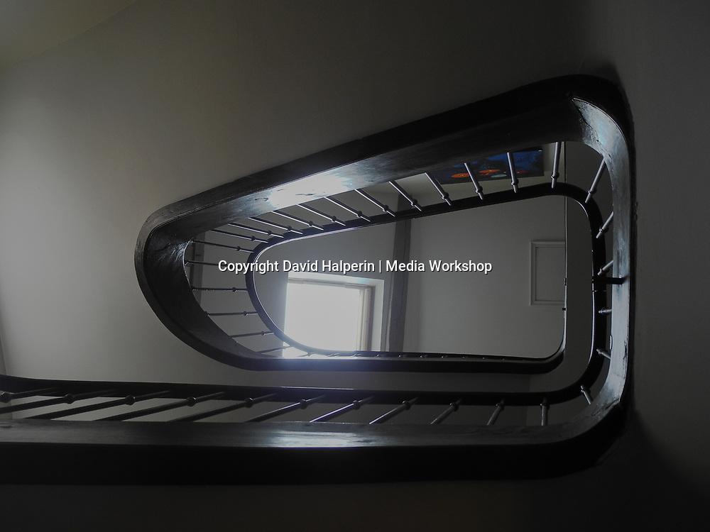 Handsome hotel stairway design, looking up.