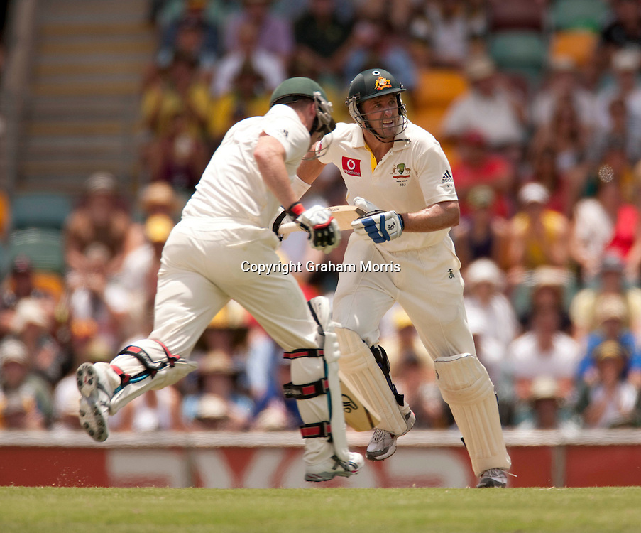 Michael Hussey and Brad Haddin (left) head towards their centuries during the first Ashes Test Match between Australia and England at the Gabba, Brisbane. Photo: Graham Morris (Tel: +44(0)20 8969 4192 Email: sales@cricketpix.com) 27/11/10