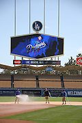 LOS ANGELES, CA - JULY 13:  Groundskeepers work on the field before the Los Angeles Dodgers game against the San Diego Padres at Dodger Stadium on Sunday, July 13, 2014 in Los Angeles, California. The Dodgers won the game 1-0. (Photo by Paul Spinelli/MLB Photos via Getty Images)