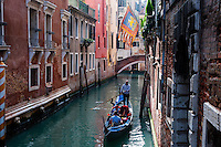 Italy, Venice. Gondola on one of the many narrow canals.