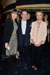 Left to right, JOOLS & CHRISTABEL HOLLAND and their daughter MABEL HOLLAND at The Hoping Foundation's 'Starry Starry Night' Benefit Evening For Palestinian Refugee Children held at The Cafe de Paris, Coventry Street, London on 19th June 2014.