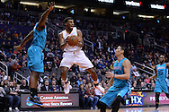 Jan 6, 2016; Phoenix, AZ, USA; Phoenix Suns guard Ronnie Price (14) looks to make a pass against the Charlotte Hornets defense in the first half at Talking Stick Resort Arena. Mandatory Credit: Jennifer Stewart-USA TODAY Sports