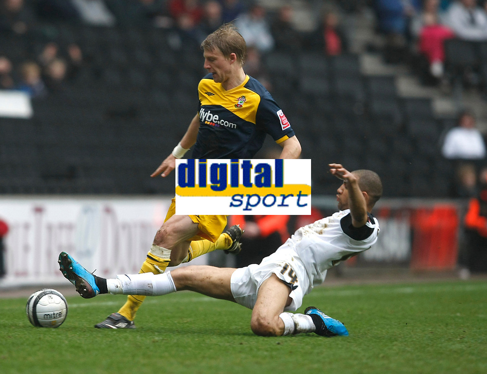 Photo: Steve Bond/Richard Lane Photography. MK Dons v Southampton. Coca-Cola Football League One. 20/03/2010. Dan Harding (L) is tackled by Lewis Gobern
