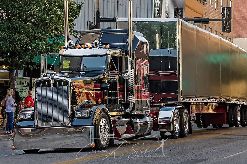 Lanita Transport's 2015 Kenworth W900L and Mac trailer travels down Main Street during the 34th annual Shell Rotella SuperRigs parade, June 10, 2016, in Joplin, Missouri. SuperRigs, organized by Shell Oil Company, is an annual beauty contest for working trucks. Approximately 89 trucks entered this year's competition. The Kenworth appears in the 2016 Shell Rotella calendar. (Photo by Carmen K. Sisson/Cloudybright)