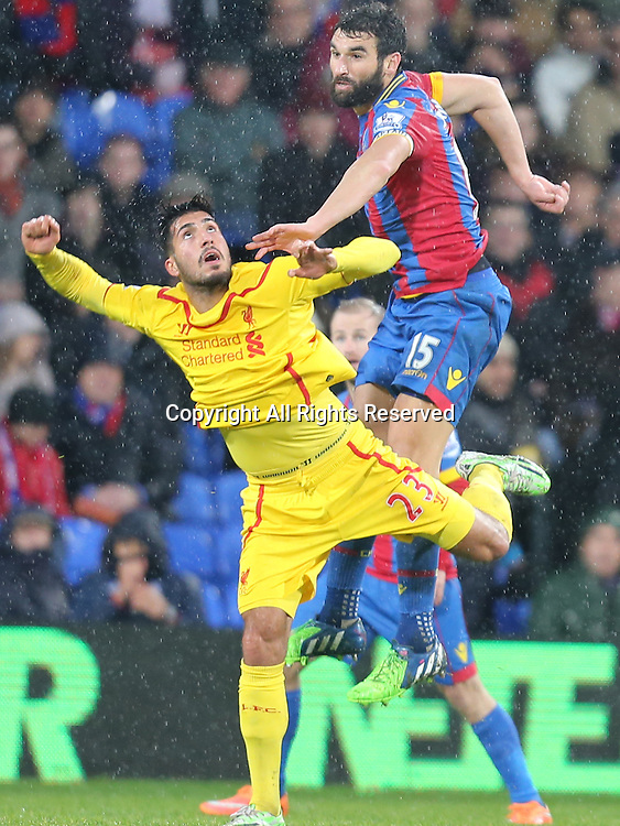 23.11.2014.  London, England. Premier League. Crystal Palace versus Liverpool. Mile Jedinak beats Emre Can for the high ball