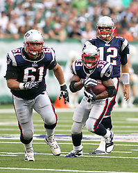 Sept 19, 2011; East Rutherford, NJ, USA; New England Patriots running back Kevin Faulk (33) follows the block of New England Patriots guard Stephen Neal (61) during the 1st half at the New Meadowlands Stadium.