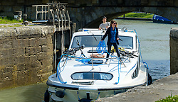 A cabin cruiser enters a lock on the Canal du Midi in Carcassonne, France<br /> <br /> (c) Andrew Wilson | Edinburgh Elite media