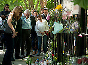 The Parents of Amy Winehouse Mitch (Blue Shirt)  and Janis  with white top and stick visit floral tributes outside number 30 Camden Square in London on July 25th 2011...Tributes have been paid to singer Amy Winehouse, 27, has been found dead at her north London home on July 23rd 2011...A Metropolitan Police spokesman said the cause of Winehouse's death was as yet unexplained...The Brit and Grammy award-winner had struggled with drink and drug addiction and had recently spent time in rehab....