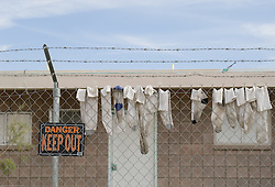 white socks hanging on a barbed wire fence in Southern California