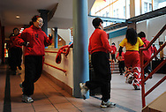 February 13, 2011 - Members of the Gund Kwok Asian Women Lion & Dragon Dance Troupe warm up at the beginning of a practice at their Den in Boston's China Town before their performance during the city's Chinese New Years celebrations.