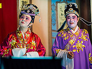 "30 JUNE 2016 - BANGKOK, THAILAND: A Chinese opera performance at Chiao Eng Piao Shrine in Bangkok. Chinese opera was once very popular in Thailand, where it is called ""Ngiew."" It is usually performed in the Teochew language. Millions of Chinese emigrated to Thailand (then Siam) in the 18th and 19th centuries and brought their culture with them. Recently the popularity of ngiew has faded as people turn to performances of opera on DVD or movies. There are about 30 Chinese opera troupes left in Bangkok and its environs. They are especially busy during Chinese New Year and Chinese holidays when they travel from Chinese temple to Chinese temple performing on stages they put up in streets near the temple, sometimes sleeping on hammocks they sling under their stage.       PHOTO BY JACK KURTZ"