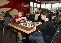 Laconia Middle students Dylan Dickey and Noah Mosseau during 2nd round play of the City Wide Chess Tournament at the Huot Technical Center on Saturday morning.  (Karen Bobotas/for the Laconia Daily Sun)