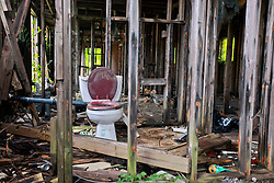 27 August 2014. Lower 9th Ward, New Orleans, Louisiana.<br /> Hurricane Katrina 9 years later. A toilet remains in one of the many derelict, falling down buildings dotting the landscape as the area continues to struggle with recovery from Hurricane Katrina.<br /> Photo; Charlie Varley/varleypix.com