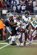 New England Patriots linebacker Geneo Grissom (96) and New England Patriots wide receiver Matthew Slater (18) stuff a kick return by Jacksonville Jaguars running back Corey Grant (30) at the Jaguars 16 yard line as the defense stiffens and the Patriots mount a fourth quarter comeback during the AFC Championship NFL playoff football game against the Jacksonville Jaguars, Sunday, Jan. 21, 2018 in Foxborough, Mass. The Patriots won the game 24-20. (©Paul Anthony Spinelli)