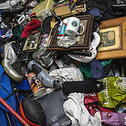 WASHINGTON, DC-OCT14: Michael Evans sorts through his belongings in his storage unit at Capital Self-Storage, October 16, 2015. Many of the area homeless have possessions they want to keep safe, just nowhere permanent to live, so they store their belongings at Capital Self-Storage, where an upper-level unit costs $30/month. Some of the homeless patrons also spend their days in their storage units, when shelters are closed during midday hours. The storage facility near 3rd and Florida Avenue in Northeast, Washington, DC, is about to be replaced by a boutique hotel. (Photo by Evelyn Hockstein/For The Washington Post)