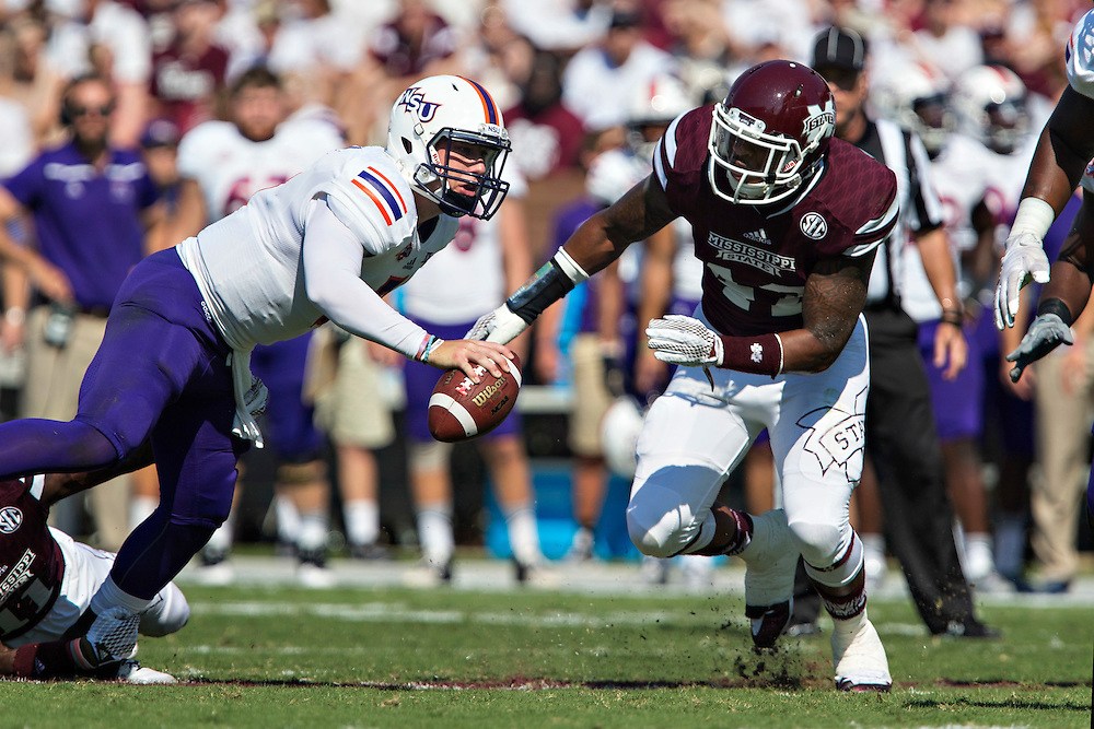 STARKVILLE, MS - SEPTEMBER 19:  Beniquez Brown #42 of the Mississippi State Bulldogs tackles Joel Blumenthal #6 of the Northwestern State Demons at Davis Wade Stadium on September 19, 2015 in Starkville, Mississippi.  The Bulldogs defeated the Demons 62-13.  (Photo by Wesley Hitt/Getty Images) *** Local Caption *** Beniquez Brown; Joel Blumenthal