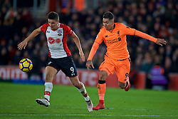 SOUTHAMPTON, ENGLAND - Sunday, February 11, 2018: Liverpool's Roberto Firmino and Southampton's Guido Carrillo during the FA Premier League match between Southampton FC and Liverpool FC at St. Mary's Stadium. (Pic by David Rawcliffe/Propaganda)