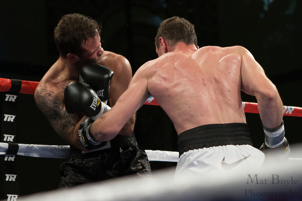 In his pro debut,  Egor Mekhontsev (White with Black Trunks from Asbest, Russia fights Peter Cajigas (Black Trunks) from Franklin Park, IL, USA in a 4 round Light Heavyweight bout at Boardwalk Hall in Atlantic City, NJ on Saturday December 7, 2013. (photo / Mat Boyle