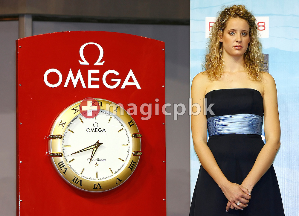 An unidentified maid-of-honor is pictured beside an Omega clock  during the European Short Course Swimming Championships in Rijeka, Croatia, Friday, Dec. 12, 2008. (Photo by Patrick B. Kraemer / MAGICPBK)