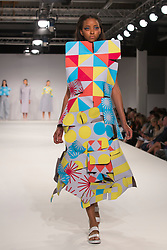 © Licensed to London News Pictures. 01/06/2014. London, England. Collection by Kirsty Sahota from UCA Epsom Fashion - university for the creative arts. Graduate Fashion Week 2014, Runway Show at the Old Truman Brewery in London, United Kingdom. Photo credit: Bettina Strenske/LNP
