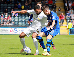 Peterborough United's Kyle Vassell in action with Rochdale's Scott Tanser - Photo mandatory by-line: Joe Dent/JMP - Mobile: 07966 386802 09/08/2014 - SPORT - FOOTBALL - Rochdale - Spotland Stadium - Rochdale AFC v Peterborough United - Sky Bet League One - First game of the season