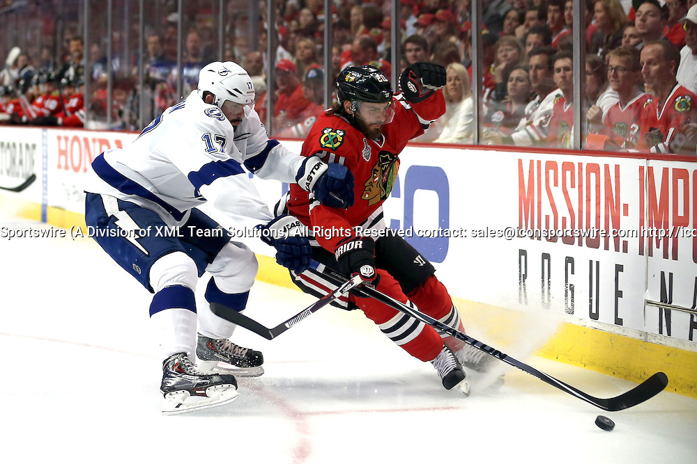 08 June 2015:  Chicago Blackhawks Left Wing Brandon Saad (20) [8995] battles with Tampa Bay Lightning Left Wing Alex Killorn (17) [6199] in action during game three of the Stanley Cup Finals between the Tampa Bay Lightning and the Chicago Blackhawks at the United Center, in Chicago, IL.