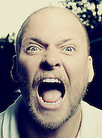 Portrait of mid-adult man screaming