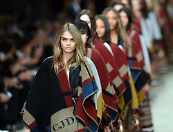 Cara Delevingne closes the  Burberry Prorsum show at London Fashion Week A/W 14, Monday, 17th February 2014. Picture by Stephen Lock / i-Images