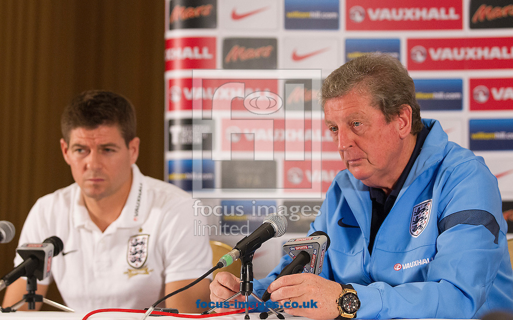 Picture by Paul Terry/Focus Images Ltd +44 7545 642257<br /> 18/11/2013<br /> Manager, Roy Hodgson ( R ) and Steven Gerrard talk during an England Press Conference at the Grove Hotel, Chandler's Cross.