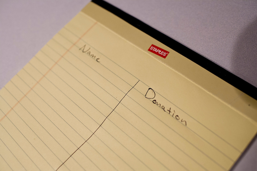 A notepad to track donations sits on a table at a Cerro Gordo County GOP Fundraiser and campaign stop for  presidential candidate Rick Perry on Friday, December 30, 2011 in Mason City, IA.