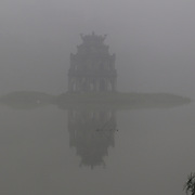 A misty morning beside Hoan Kiem Lake, Hanoi, Vietnam, with the Thap Rue Pagoda visible through the mist. Hanoi is the capital of Vietnam and the country's second largest city. Hanoi, Vietnam. 17th March 2012. Photo Tim Clayton