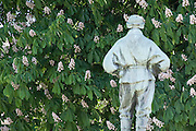 "Dr Edward Wilson contemplates a  Horse chestnut tree, Cheltenham  in the Long Garden in front of the Municipal Offices. ..In 1910 he joined the famous Captain Scott on his National Antarctic Expedition to the South Pole, but tragically both men died in March 1912 on the return journey...News of Wilsons death reached Cheltenham in February 1913 and a fund was set up to create a memorial to the explorer. The original plan was for two plaques to be hung in the Town Hall but Wilsons widow suggested that as Edward loved the outdoors a more suitable memorial should be erected. The bronze statue shown was modelled by Scotts widow and was unveiled on 9th July 1914 by Arctic explorer Sir Clarence Markham. A display of Wilsons Arctic clothing and kit, as well as some of his artwork, can be found at the Cheltenham Art Gallery and Museum...The inscription on the plinth of the statue reads - ""He died as he lived, A brave true man. The best of comrades and the staunchest of friends."""