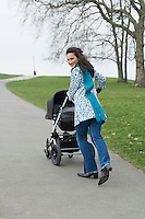 Mother pushing stroller in park