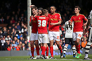 Nottingham Forest midfielder Henri Lansbury (10) celebrating scoring penalty 0-2 during the Sky Bet Championship match between Fulham and Nottingham Forest at Craven Cottage, London, England on 23 April 2016. Photo by Matthew Redman.