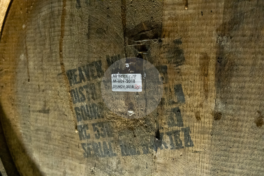 Detail of a batch of tequila in the barrel room at the Casa Siete Leguas, El Centenario tequila distillery in Atotonilco de Alto, Jalisco, Mexico. The tequila is aged from 2-12 years in white oak barrels that once held American Kentucky Bourbon. The Seven Leagues tequila distillery is the oldest family owned distillery producing authentic handcrafted tequila using traditional methods.