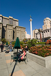 California, San Francisco: Couple relaxing at Union Square. Photo 6-casanf79263.  Photo copyright Lee Foster.