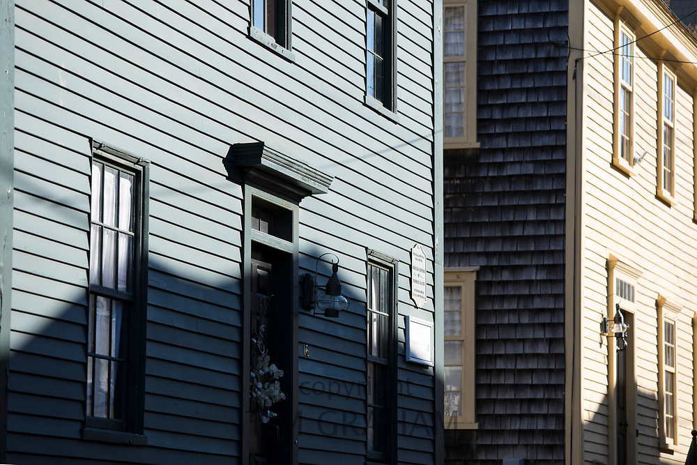 Traditional wood clapboard and cedar shingle homes in Newport, Rhode Island, USA