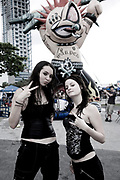 Two punk girls looking at the camera. Vans Warped Tour, USA touring punk rock music festival, Bicentennial park, Miami, Florida, USA. 24th June 2006