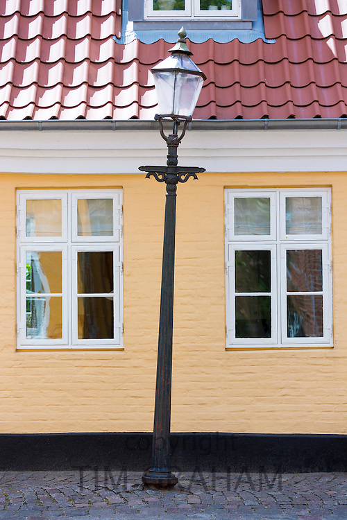 Traditional old-fashioned lamp post and street scene in Gronnegade in medieval Ribe centre, South Jutland, Denmark