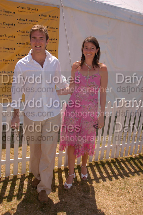 Tom Rutherford and Naomi Franks. Veuve Clicquot Gold Cup Final at Cowdray Park. Midhurst. 17 July 2005. ONE TIME USE ONLY - DO NOT ARCHIVE  © Copyright Photograph by Dafydd Jones 66 Stockwell Park Rd. London SW9 0DA Tel 020 7733 0108 www.dafjones.com